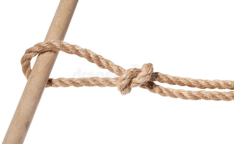 Noeud courant attaché sur la corde épaisse de jute d'isolement photos stock