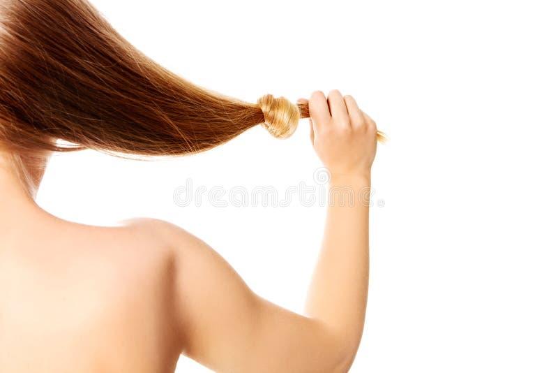 Noeud de cheveux blonds d'isolement sur le fond blanc image libre de droits
