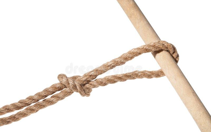 noeud renversé glissé attaché sur la corde de jute d'isolement images stock