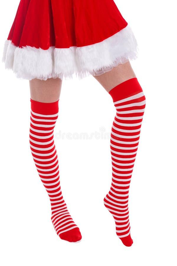 Noga dziewczyna na palec u nogi stoi w pończochach na białym tle obrazy stock