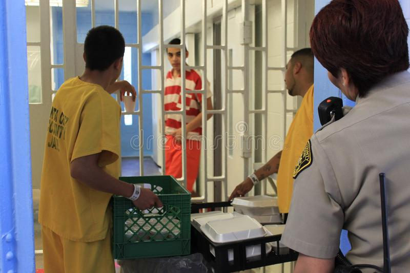 Nogales old jail inmates 4496. Nogales, Ariz. / US - March 8, 2011: Santa Cruz County Sheriff`s Office deputies work with inmates in the old, outdated jail just stock photo