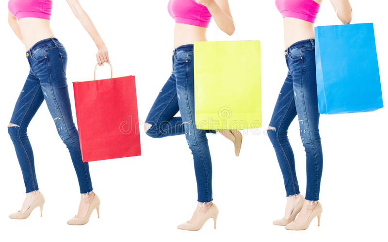 Nogi kupujący z torba na zakupy zdjęcia royalty free