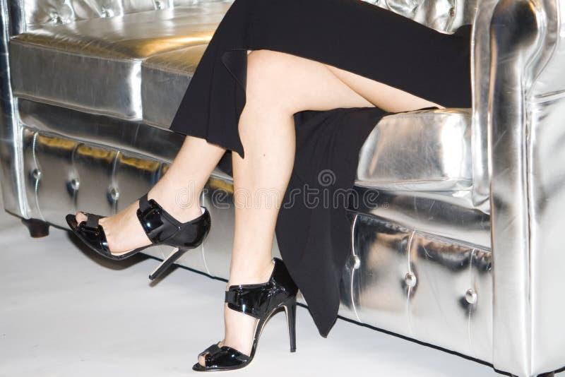 Nogi na kanapie fotografia royalty free