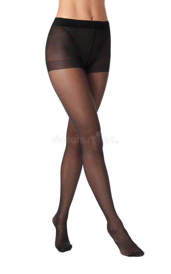 Nogi piękna młoda kobieta w czarnych rajstopy obraz stock