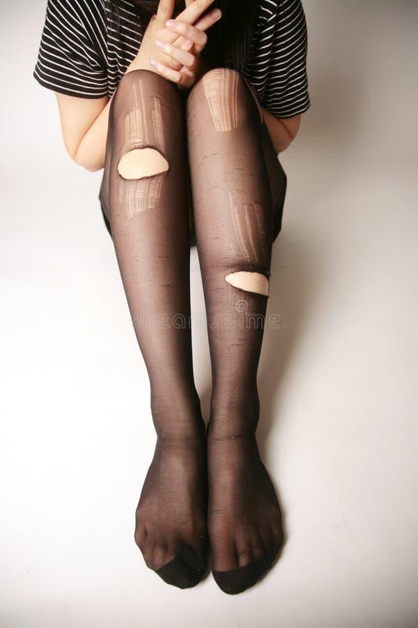 nogi rajstopy drzejącego fotografia stock