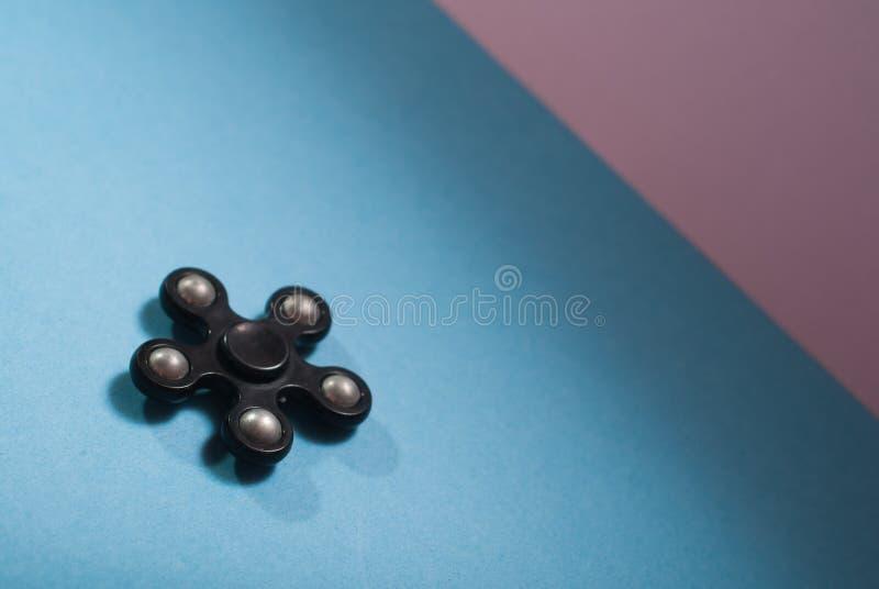 Noir de fileur de personne remuante, instrument pour soulager l'effort photos stock