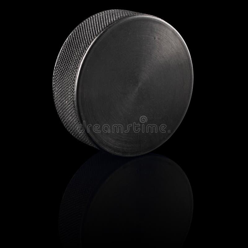 Noir de galet de hockey sur glace photo stock