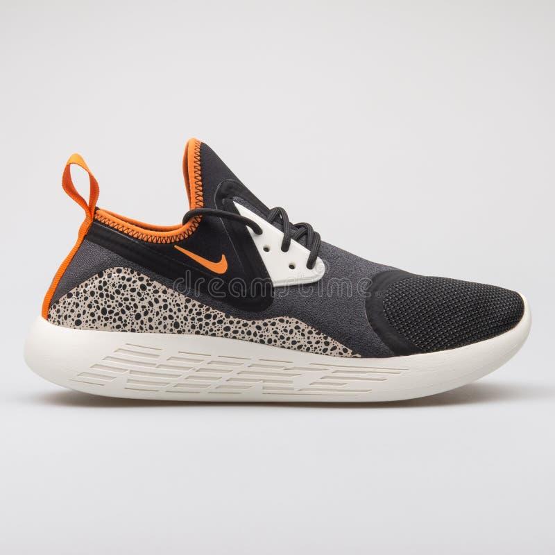 Noir de MILLIARD de Nike Lunarcharge et espadrille orange photos libres de droits