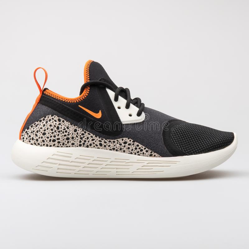 Noir de MILLIARD de Nike Lunarcharge et espadrille orange image stock