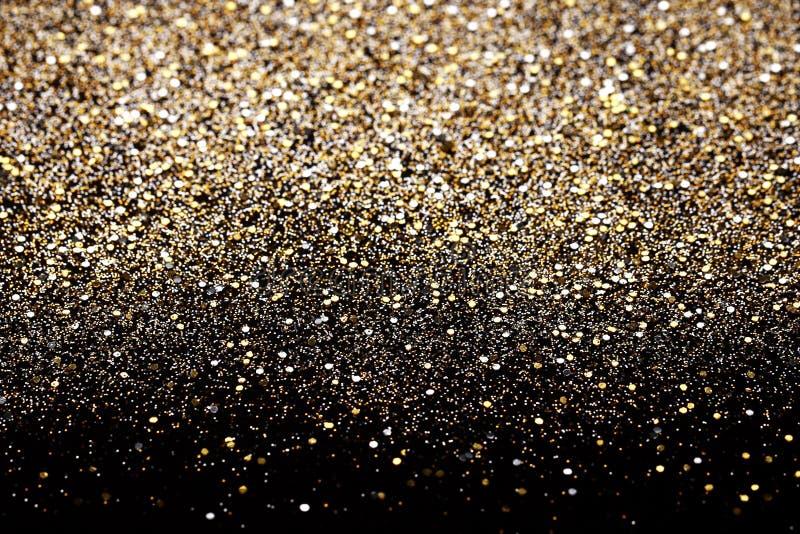 Noir de nouvelle année de Noël et fond de scintillement d'or Tissu abstrait de texture de vacances photographie stock libre de droits