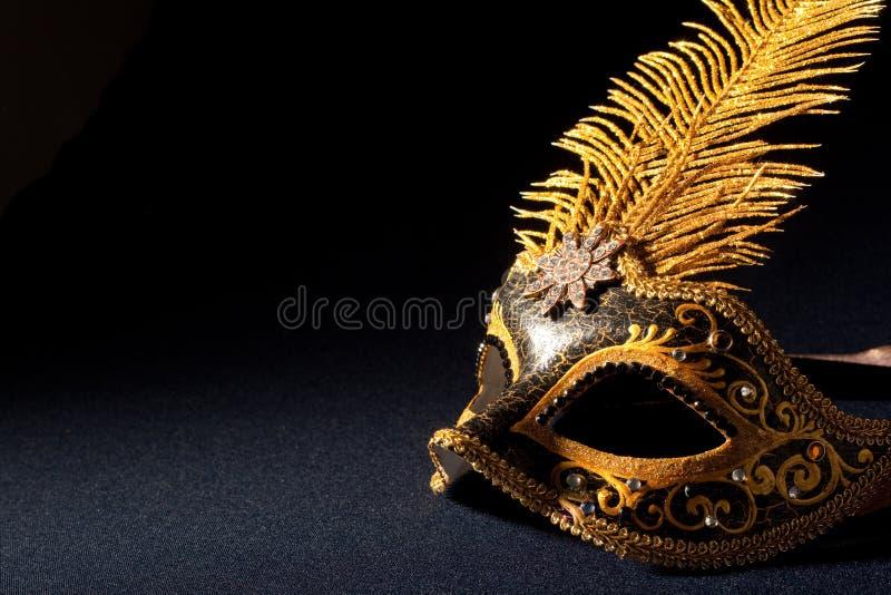 Noir et masque d'or photos stock