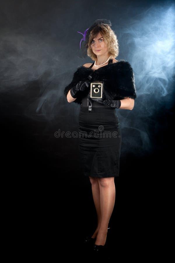 Noir flickakamera för film arkivfoton