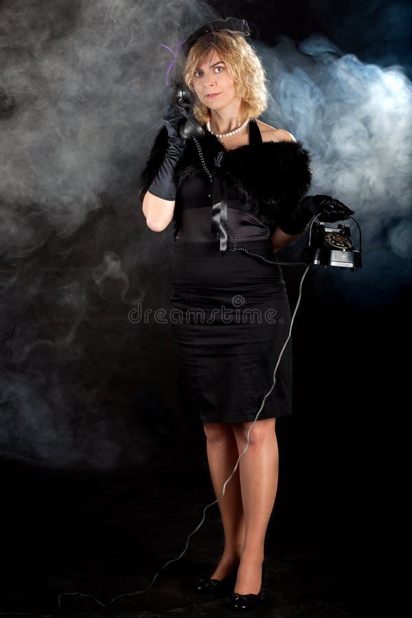 Noir flickatelefon för film arkivfoton
