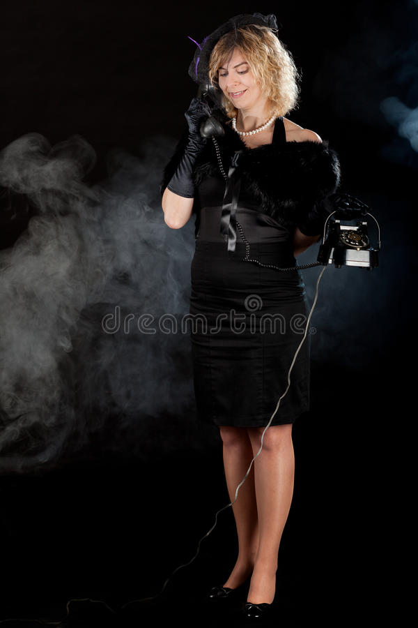Noir flickatelefon för film arkivbilder