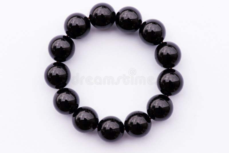 Noircissez le bracelet d'onyx photo libre de droits