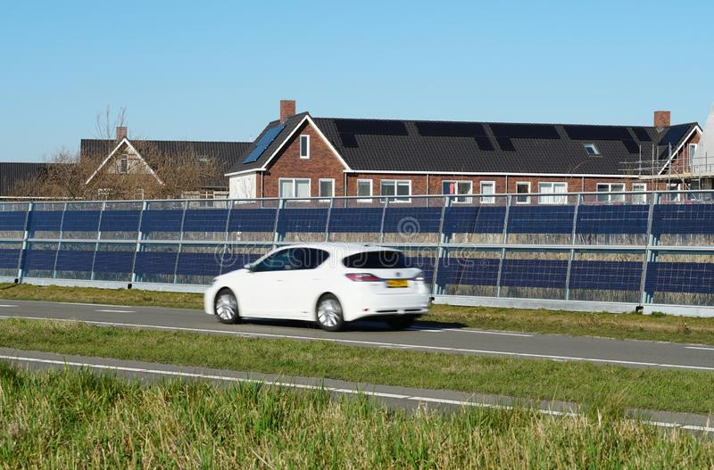Noise barrier with integrated solar panels royalty free stock photography