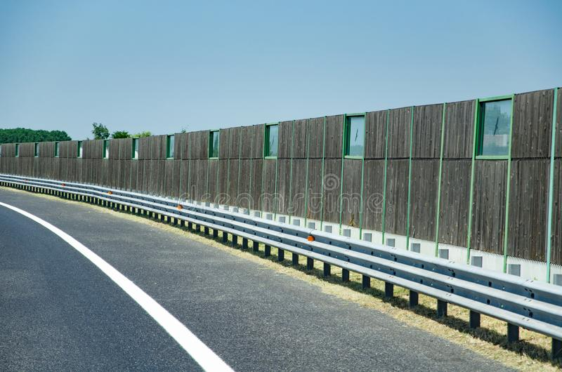 Noise protection fence along the road royalty free stock photo