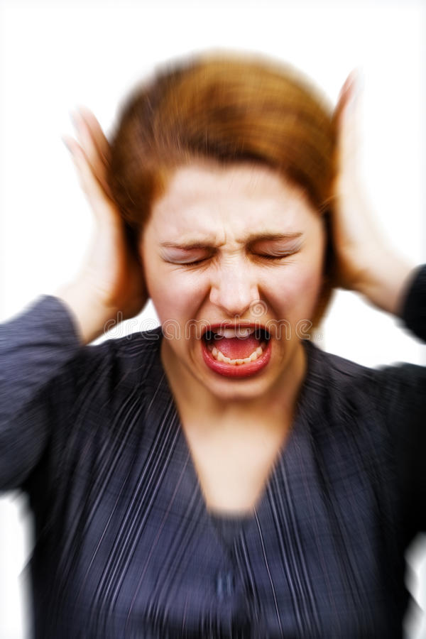 Noise and stress concept - woman covering ears royalty free stock image