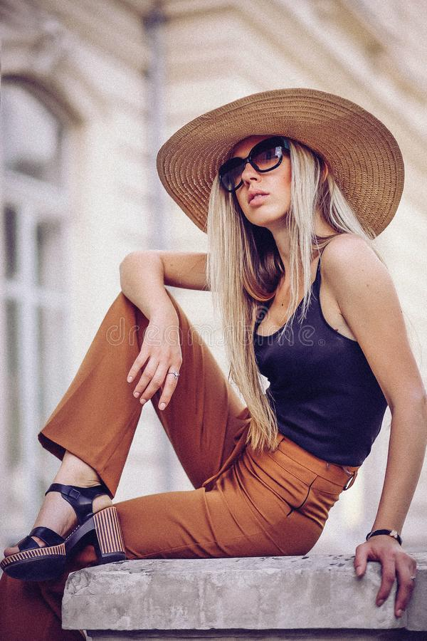 Noise. Vintage Style. Beautiful elegant woman in hat outdoor. Fa. Shion look, european style stock photography