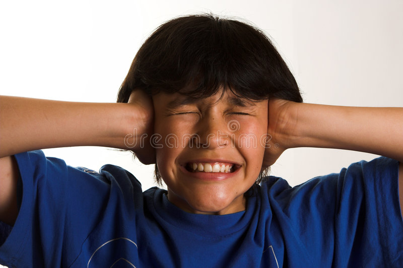 Noisy. Boy getting crazy due to noise stock photography