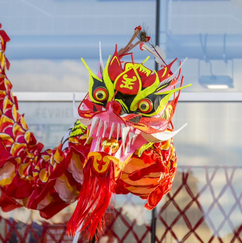 The Chinese Dragon - The Year of the Dog, 2018. Noisy-le-Grand, France - February 18,2018: The head of the Dragon during the Chinese New Year parade in Nosy-le stock photo