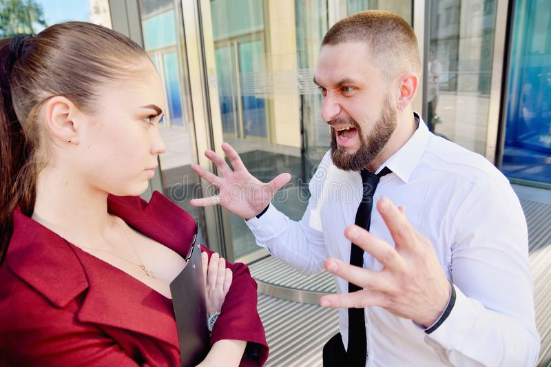 Noisy quarrel with the head of the office employee. A man scream royalty free stock photos