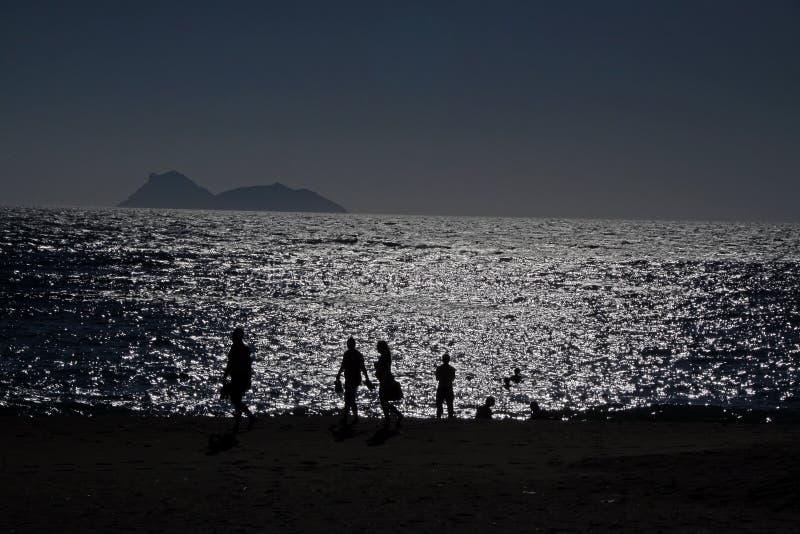 Noite na praia imagem de stock