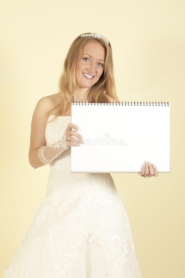 Noiva com um cartaz nas mãos de imagem de stock