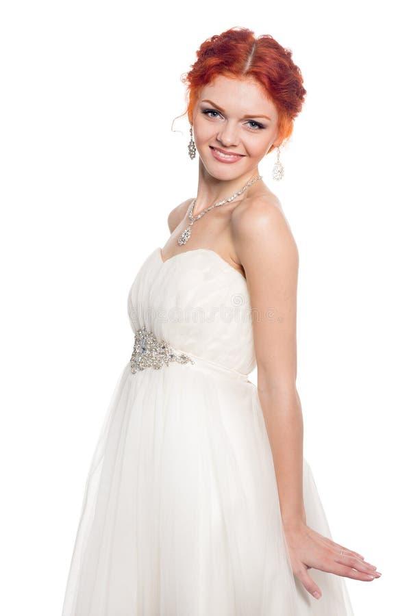 Noiva de sorriso em um vestido da gala foto de stock
