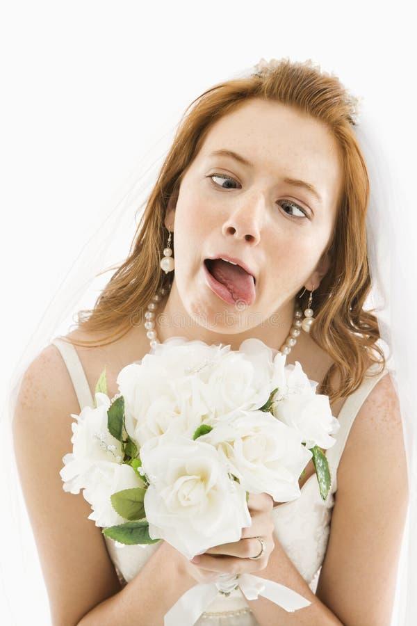 Noiva que faz a face engraçada. imagens de stock royalty free