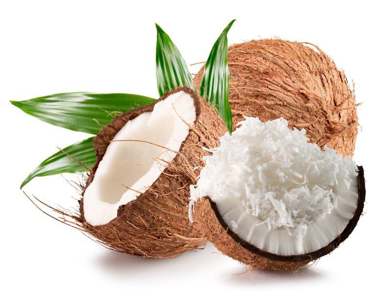 Noix de coco avec des flocons de noix de coco d'isolement sur un fond blanc photographie stock libre de droits