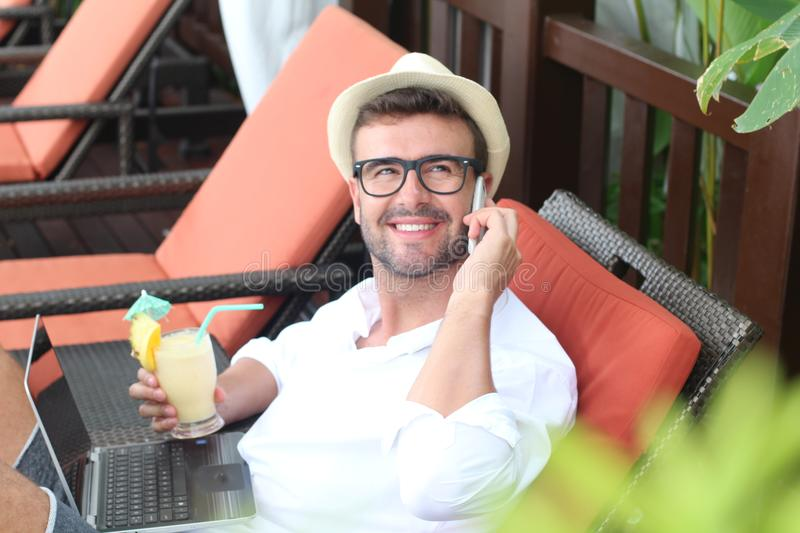 Nomad businessman working from a resort.  royalty free stock photos