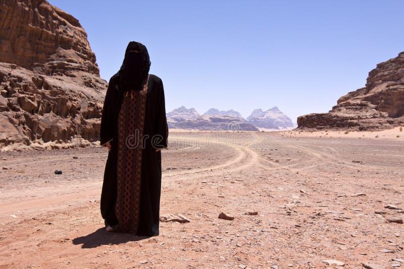 Nomadic woman with burka in wadi rum royalty free stock images