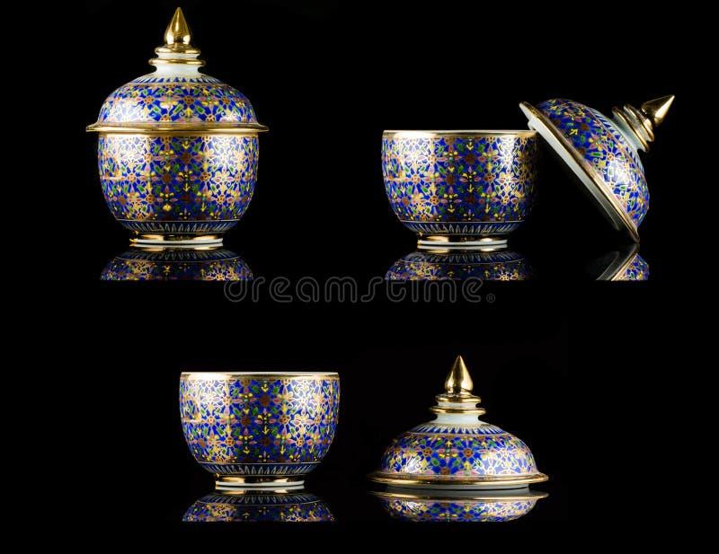 Nombre de la porcelana tailandesa con diseños en cinco colores foto de archivo libre de regalías