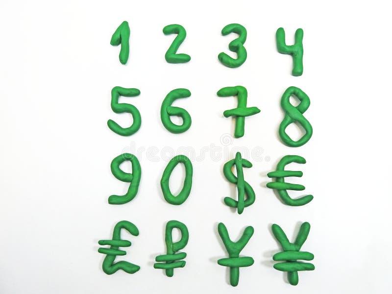 Nombres et devise verts d'argent image stock