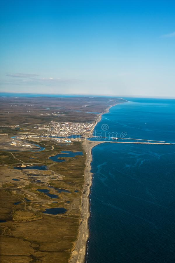 Nome Along the Bering Sea. An aerial view of the city of Nome Alaska along the Bering Sea royalty free stock photo