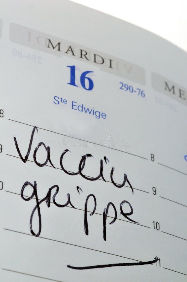 Nomeação para uma vacina contra a gripe escrita em francês foto de stock