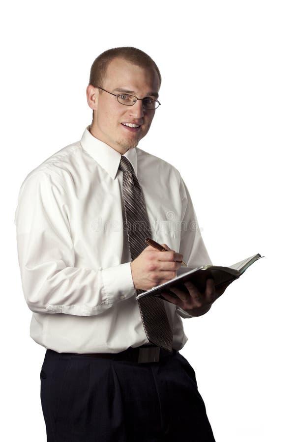 nominacyjnej książki mężczyzna writing zdjęcia royalty free