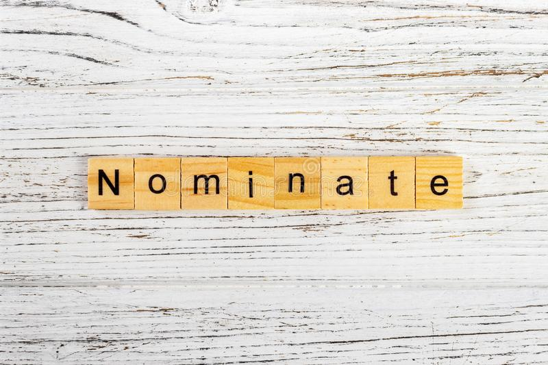NOMINATE word made with wooden blocks concept.  royalty free stock image