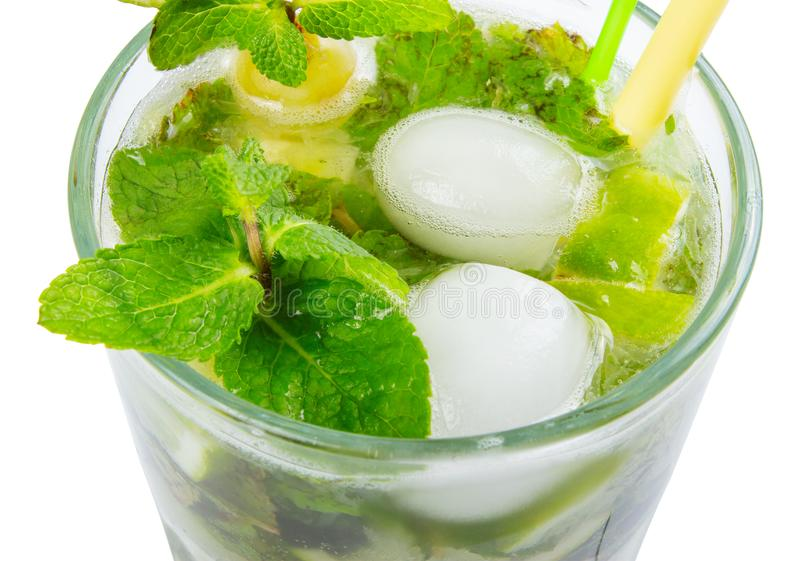 Non alcohol mojito with ice. Mint and lime in a tall glass. closeup view from the top isolated on a white background stock photos