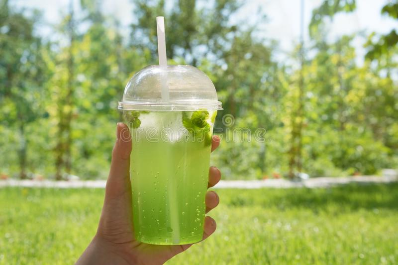 Non-alcoholic lime take away beverage in plastic cup.  stock photo