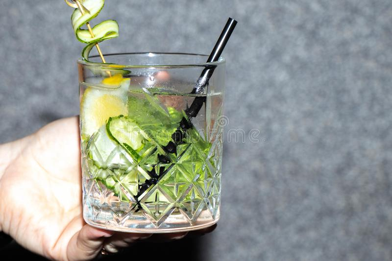 Non-alcoholic Mojito cocktail in a transparent, not tall glass. royalty free stock images