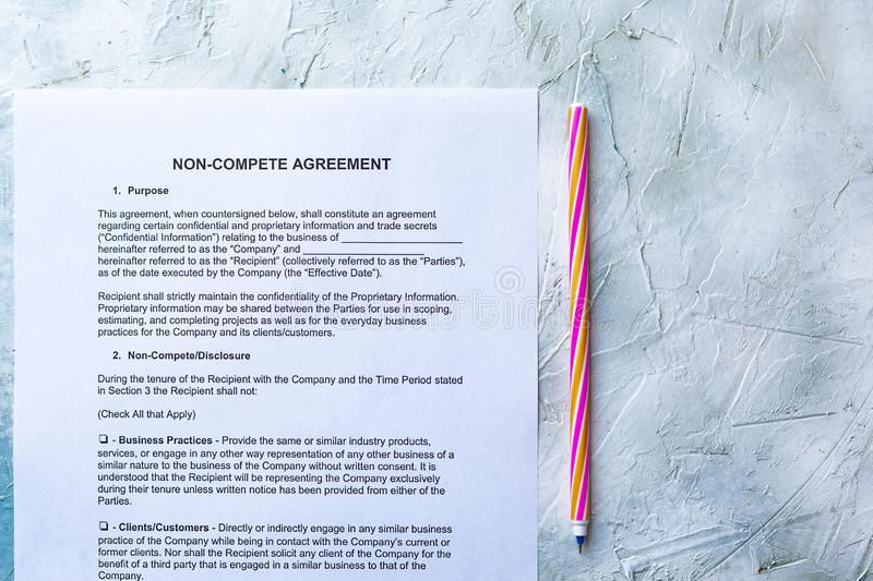 Non-Compete Agreement form. Filling Non-Compete Agreement Form. View from above stock images