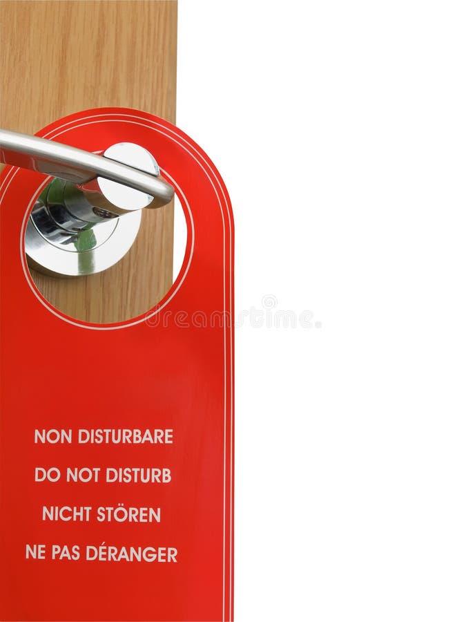 Non disturbi il segno che appende sulla maniglia di portello fotografie stock