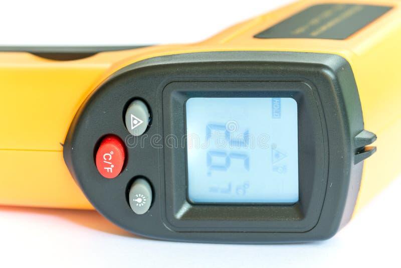 Non jaune infrarouge de thermomètre numérique de contact photographie stock libre de droits