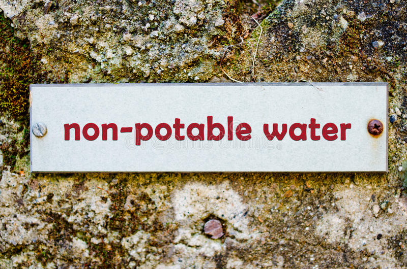 Non-potable water. Label for non-potable water on old wall stock photo