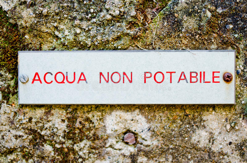 Non-potable water. Label for non-potable water on old wall in italy stock images