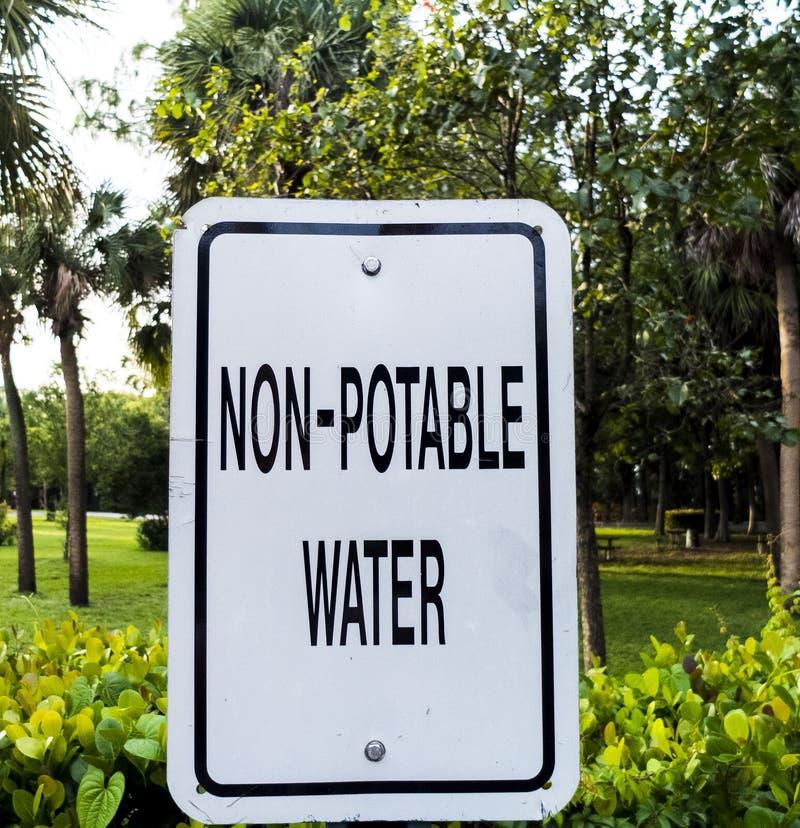 Non-Potable Water Metal Sign at a Public Park. Black and White Metal Sign for Non-Potable Water at an RV Park stock photo
