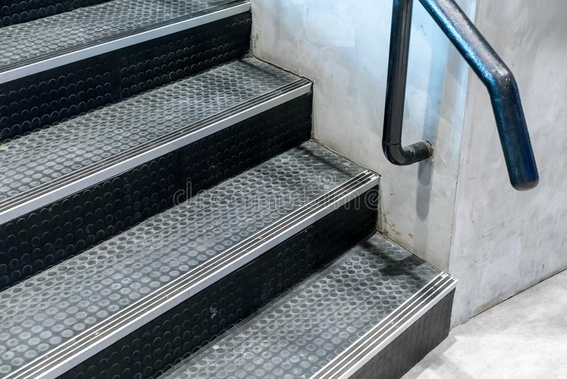 Non-slip stairs with dot pattern close up for background. Black rubber stairs royalty free stock photos