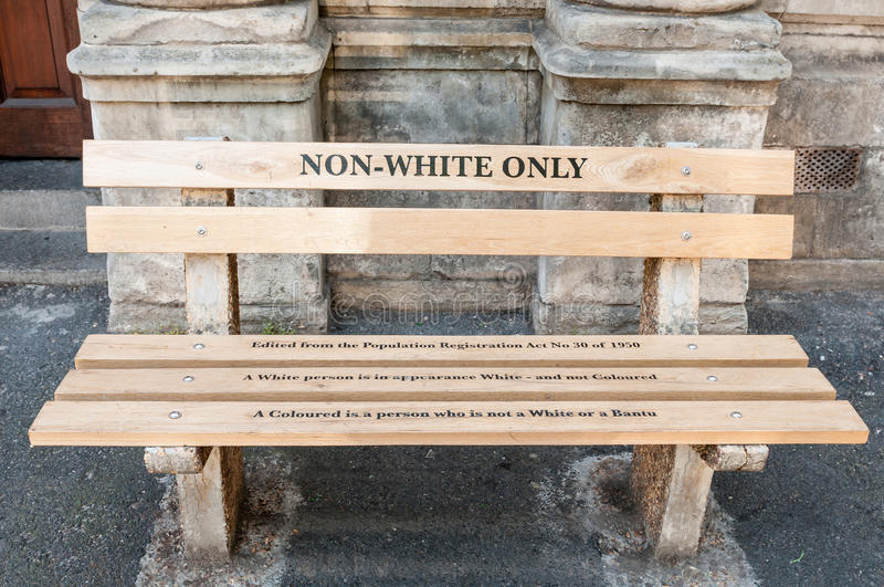 Non Whites only -reconstructed apartheid bench in Cape Town. CAPE TOWN, SOUTH AFRICA - DECEMBER 18TH, 2014: Reconstructed apartheid bench in front of the High stock image